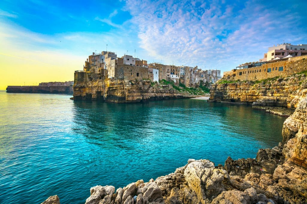 Polignano a Mare village on the rocks at sunrise, Bari, Apulia, southern Italy. Europe.