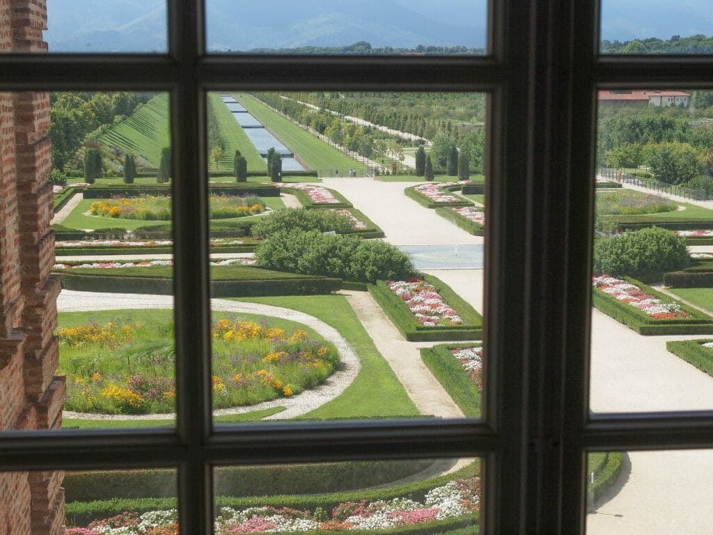 Gardens of the Reggia di Venaria Reale photographed through a window from the palace