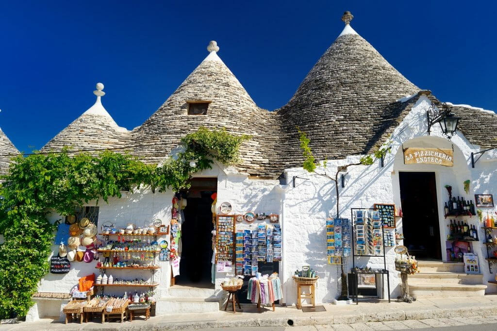 ALBEROBELLO, ITALY - Traditional trulli houses whitewashed round houses with coneshaped grey roofs