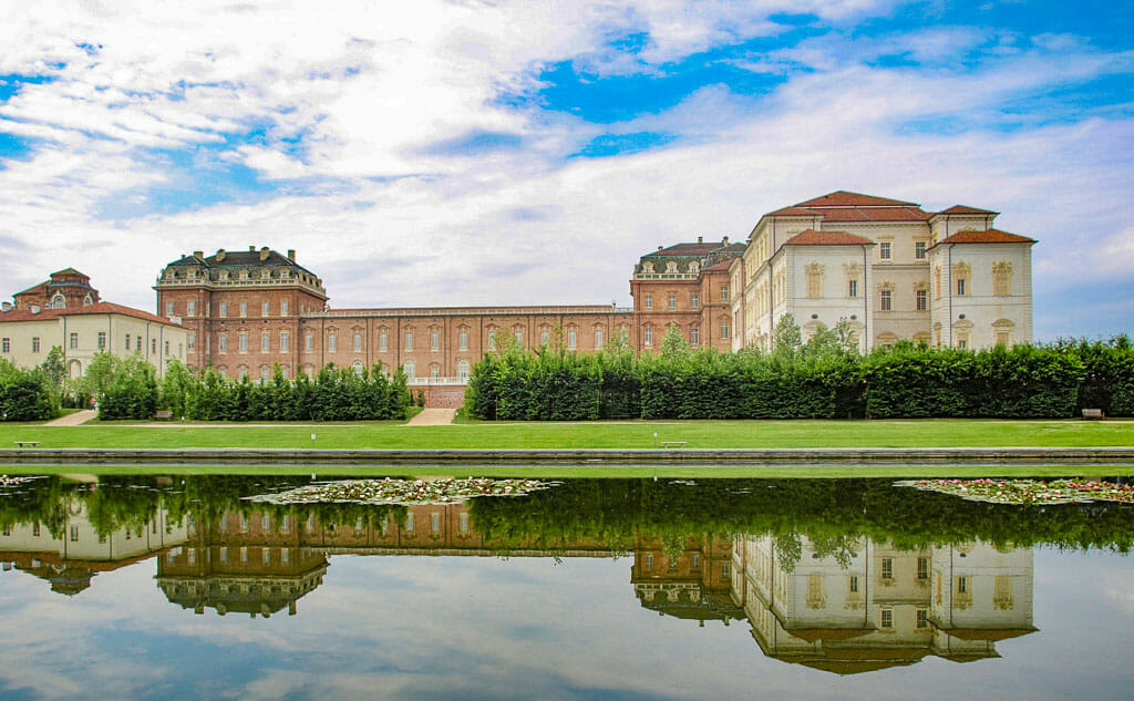 Palace building with reflection in pond in front. Reggia di Venaria Reale (Royal Palace) near Turin, Italy