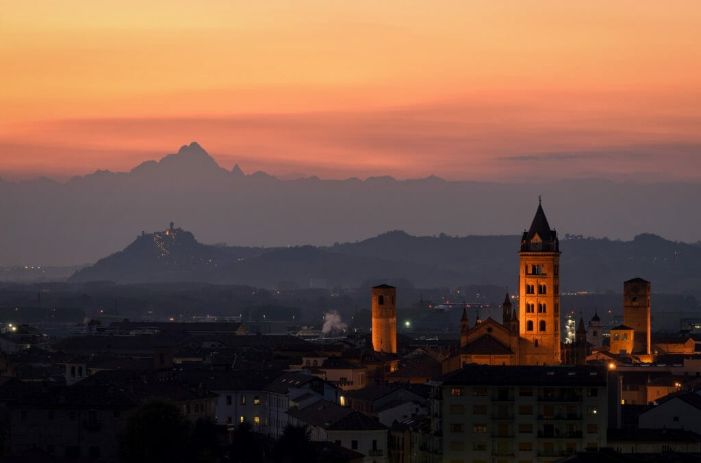 Alba at sunset and Monviso in the background