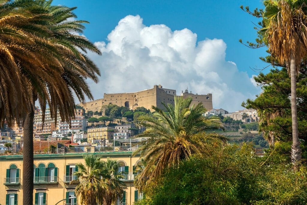 cityscape with Castel Sant Elmo, medieval fortress located on a hilltop near the Certosa di San Martino, Naples, Italy