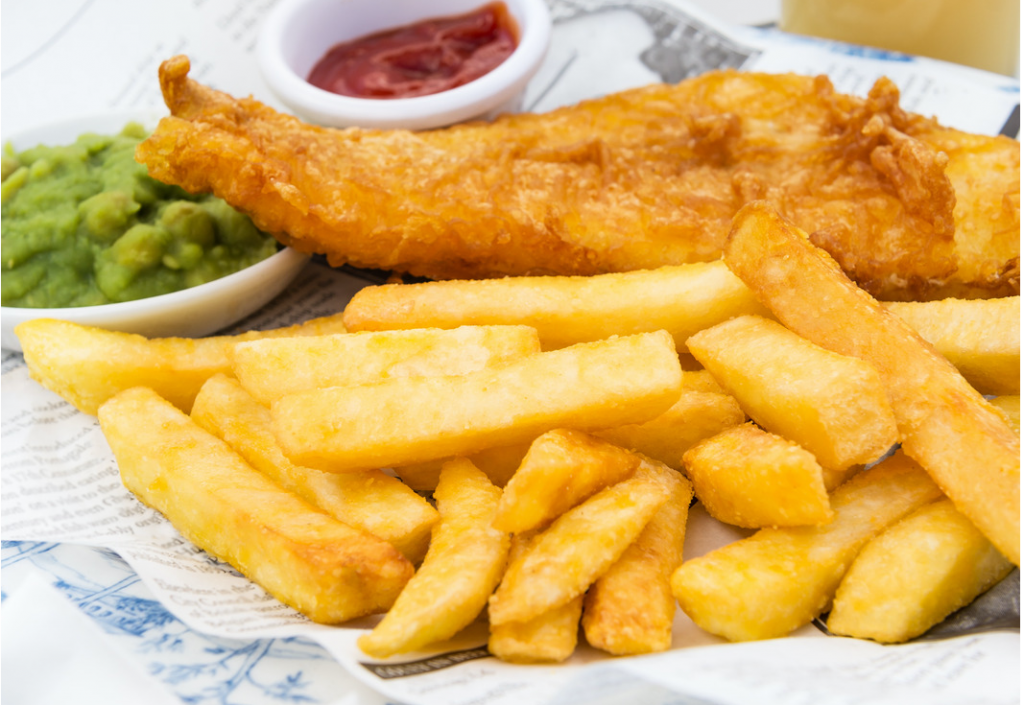 plate with Fish and Chips, a small bowl of mushy peas and ketchup
