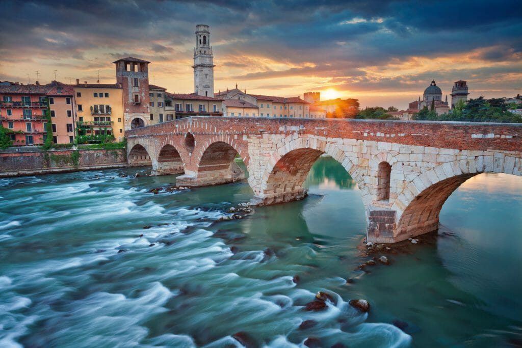 Image of bridge in Verona, Italy during summer sunset.