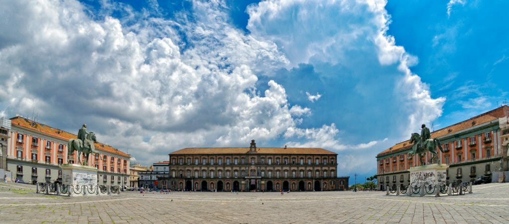 Large Piazza in Naples with blue sky and dramatic clouds