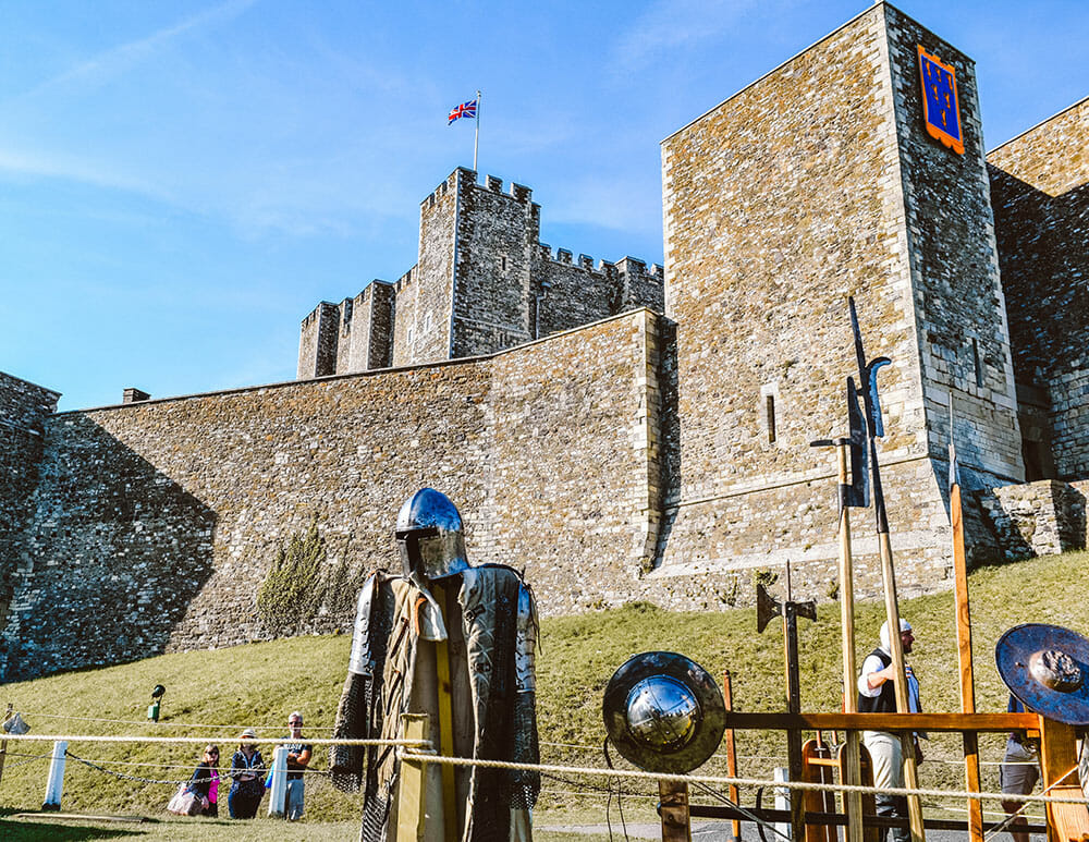 Dover Castle with shiny armor in the foreground