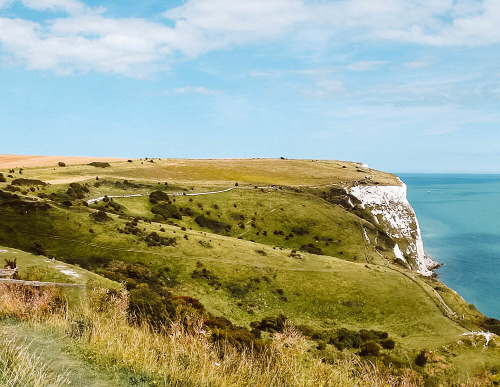 View of green grassy plateau at the white cliffs of dover - Things to do in Dover