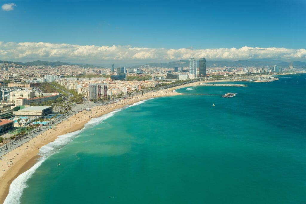 Aerial view of Barcelona, Barceloneta beach and Mediterranean sea in summer day at Barcelona, Spain.