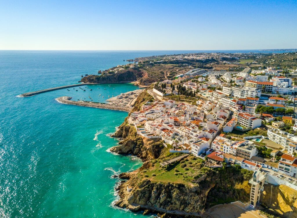 Aerial view of marina and white architecture above cliffs in Albufeira, Algarve, Portugal