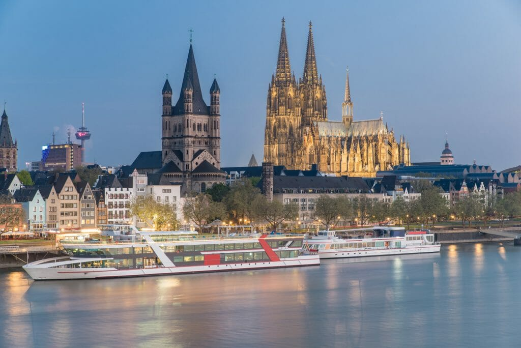 Aerial view over the Rhine River with cruise ship in Cologne, Germany