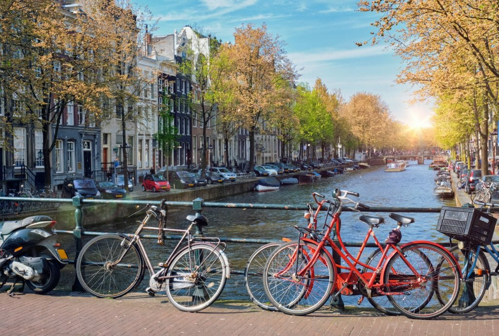 Amterdam cityscape with canal, bridge with bicycles and medieval houses. Amsterdam, Netherlands