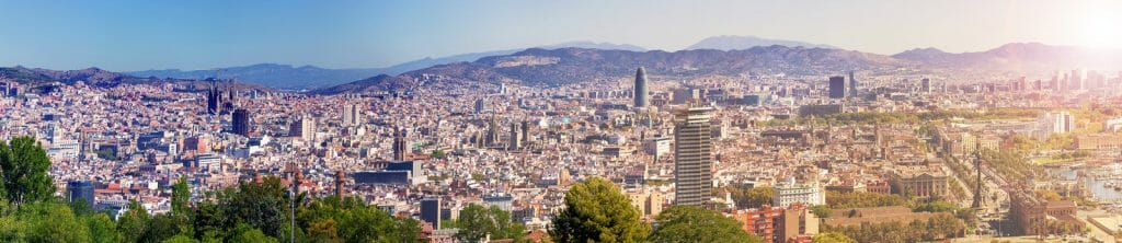 Panoramic Cityscape of the whole city of Barcelona from the Montjuic mountain. Aerial view. Spain.