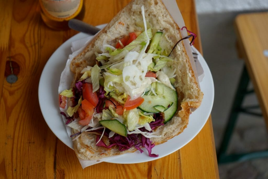 Döner kebab - pita bread stuffed with lettuce, tomato, cheese, and grilled lamb