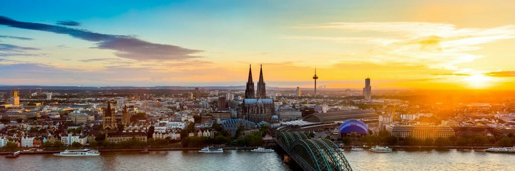 Panoramic picture of Cologne Germany Skyline at sunset