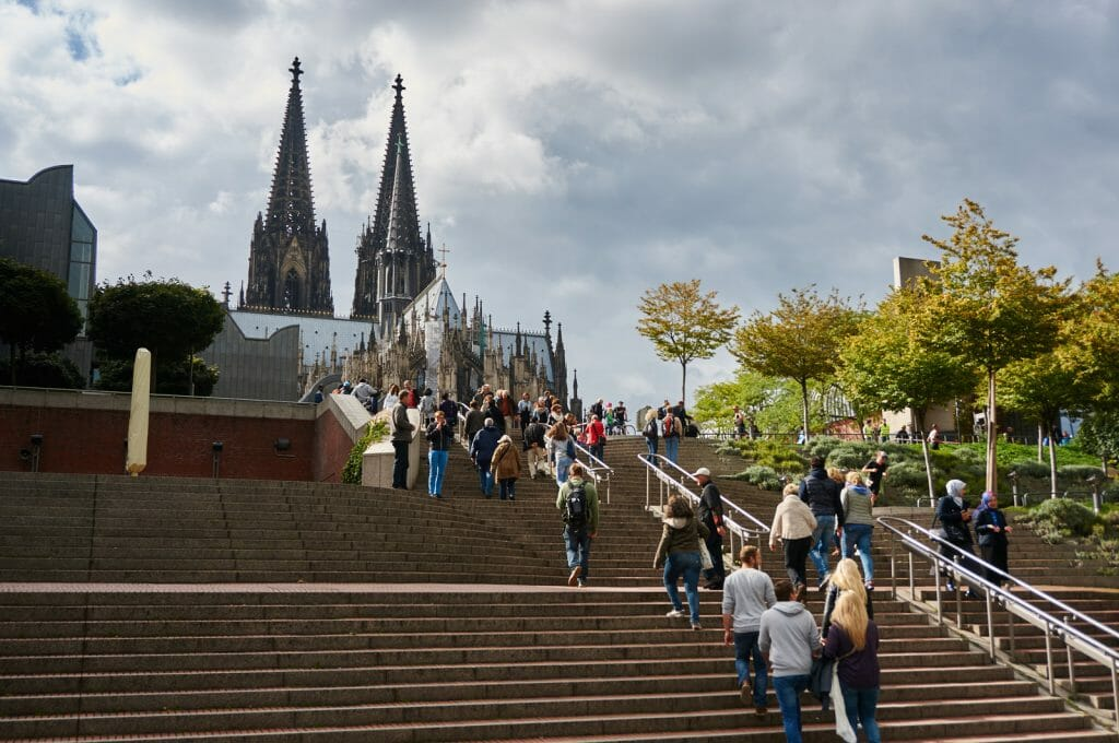 Cologne Cathedral Koelner Dom seen from Museum Ludwig square with large set of stairs in the foreground