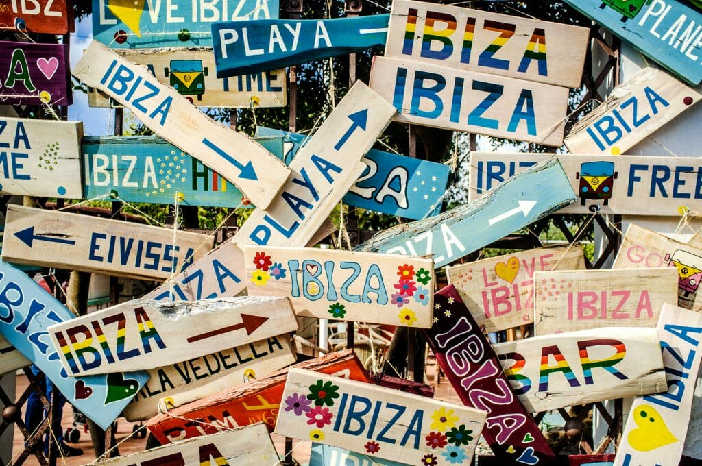 a pile of signs with Ibiza written on them