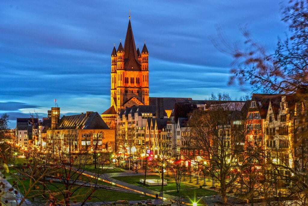 Oldtown Cologne during the blue hour with medieva buildings and a tower