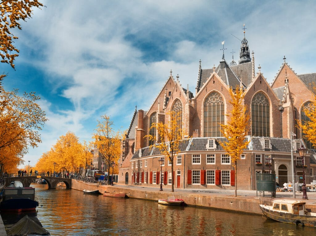 Oude Kerk over canal, Amsterdam at fall, Holland