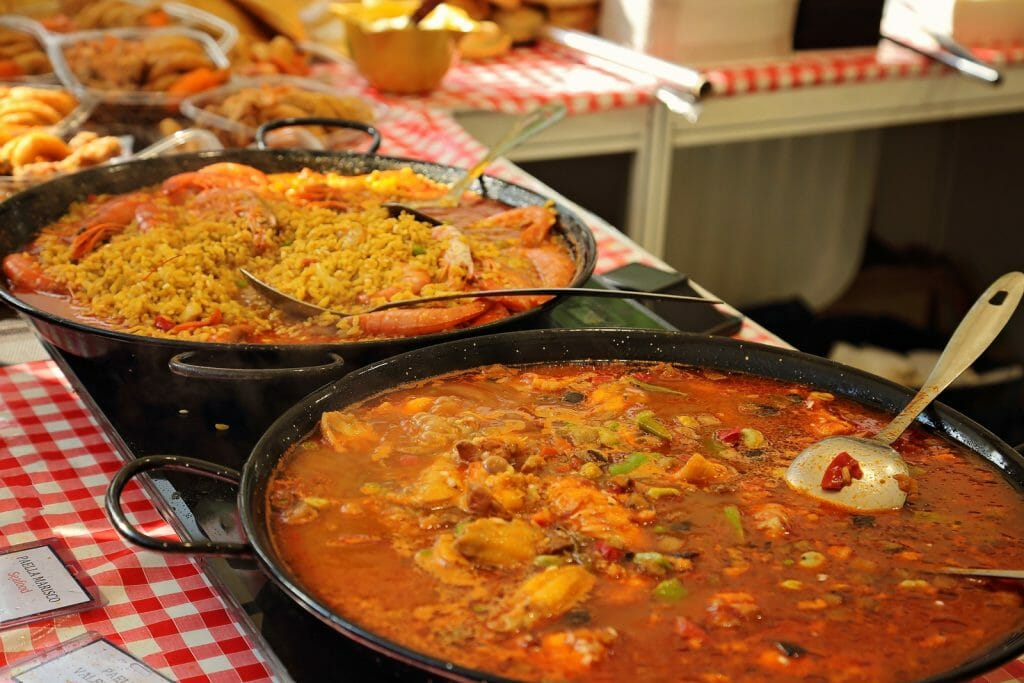 Street food stand with several pans of different Paellas in Barcelona Spain