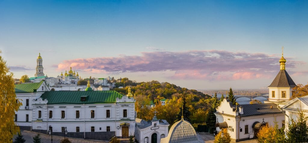 Panorama of Kiev-Pechersk Lavra in autumn against the evening sky with clouds. Kiev, Ukraine