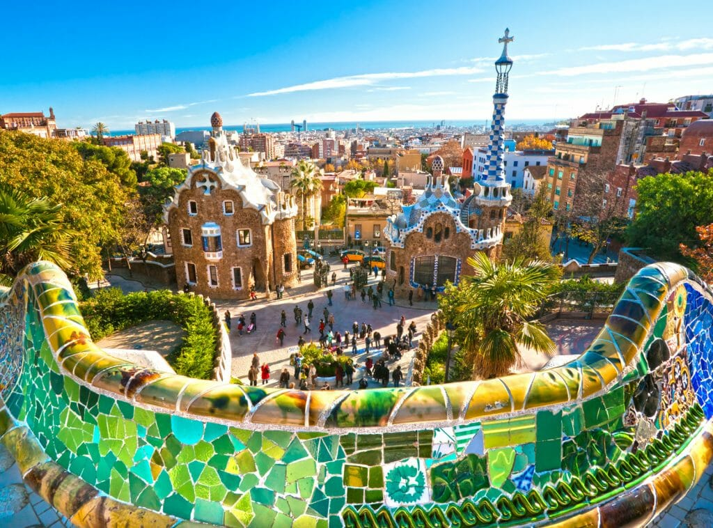 Weekend in Barcelona view over Park Guell in Barcelona, Spain with brightly colored Gaudi buildings