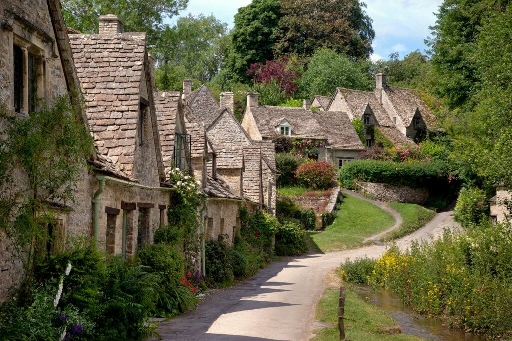 Old stone houses on Arlington Row, Bibury, Cirencester, Gloucestershire, England.