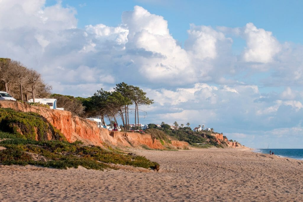 Beautiful sandy beaches and pine trees in Quarteira, Algarve, Portugal