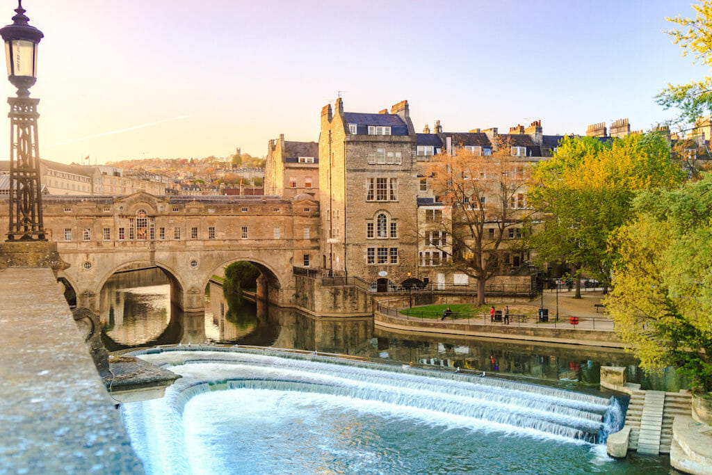 Avon river in the foreground and buildings of Bath, England in the background
