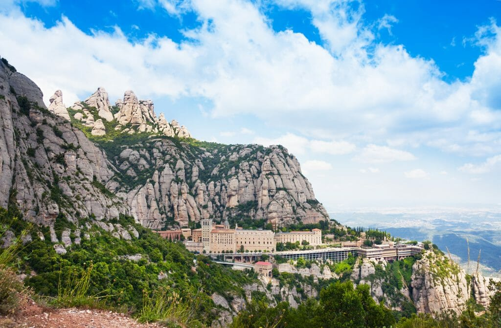 Aerial view of the Montserrat monastery. Santa Maria de Montserrat is a Benedictine abbey located on the mountain of Montserrat, in Monistrol de Montserrat, in Catalonia, Spain