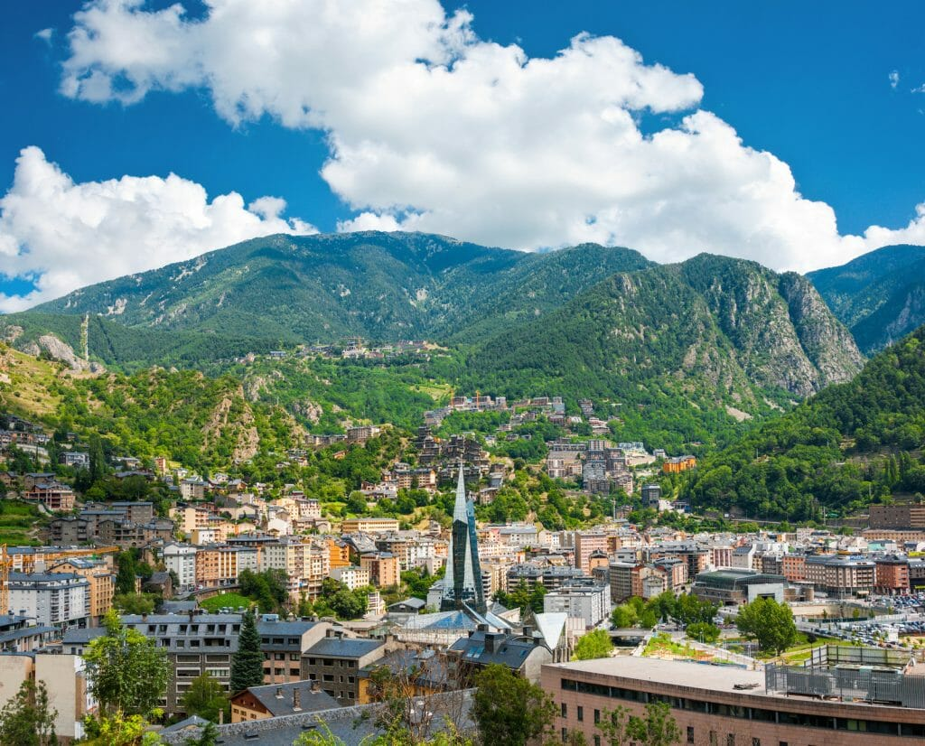 Andorra la Vella under puffy clouds, Andorra Day trip from Barcelona