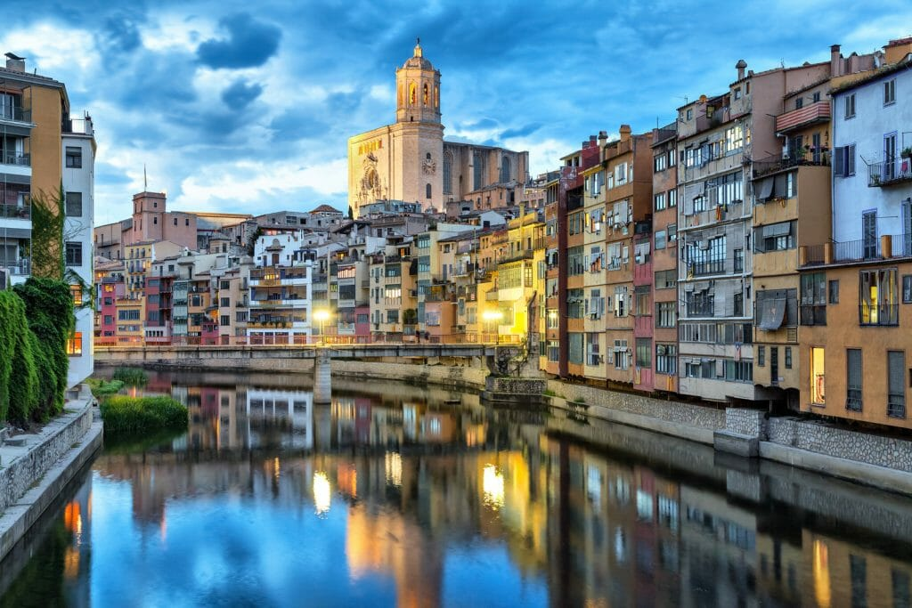 Cathedral and colorful houses on the side of river Onyar in the evening, Girona, Catalonia, Spain