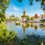 Classic panorama view of the historic city of Luebeck with famous Trave river in summer, Schleswig-Holstein, Most Romantic Cities in Northern Germany