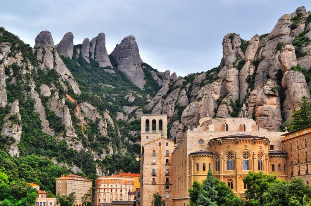 Monastery  de Montserrat built into the side of the mountains Spain