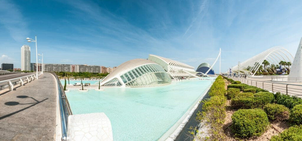 Modern white building surrounded by turquoise water pools - modern architecture in Valencia Spain