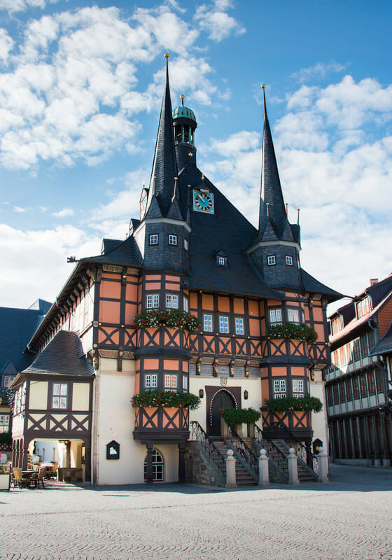 town sqaure with town hall with spires and half timbered design in wernigerode germany