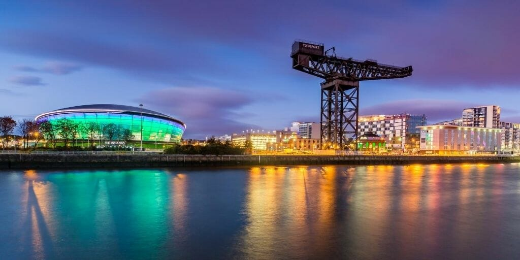 Finnieston Crane in Glasgow during sunset with lights reflecting in the Clyde river