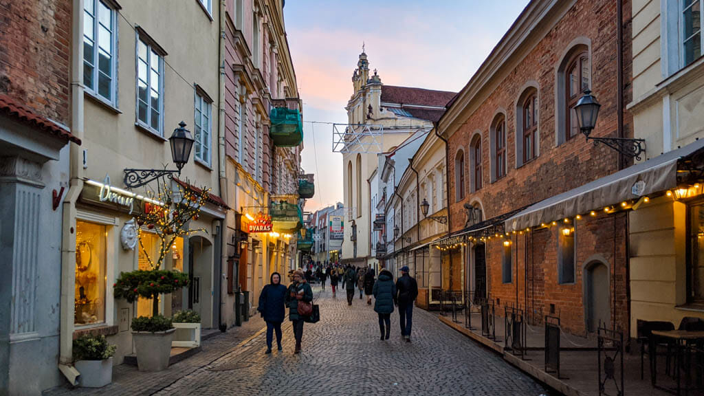 People walking on cobble stoned street in old town vilnius lithuania