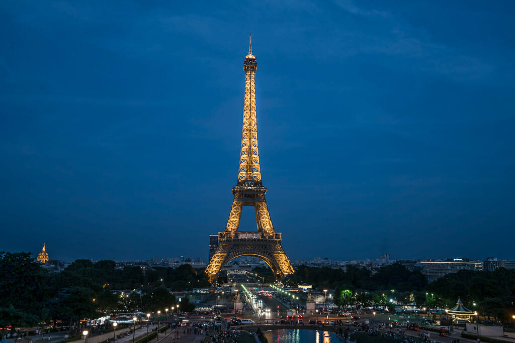 Eiffel Tower from Trocadero during blue hour with lights on tower
