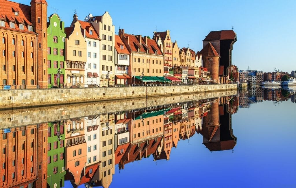 Colorful rowhouses in Gdansk Poland on the waterfront with reflections in the water