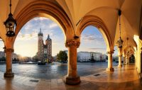 Krakow Poland main square church photographed through vaulted arched walkway - Poland Trip