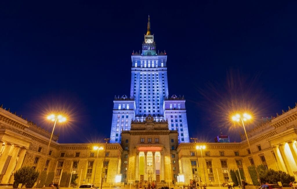 Tower and building of the Palace Of Culture and Science photographed at night