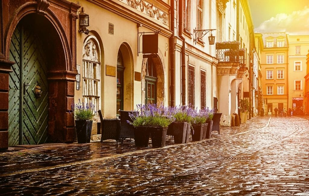 Historic Buildings on cobblestoned street in Old Town Krakow
