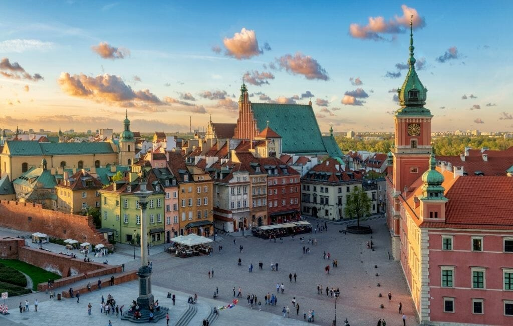 aerial shot of Warsaw old town with royal palace during sunrise