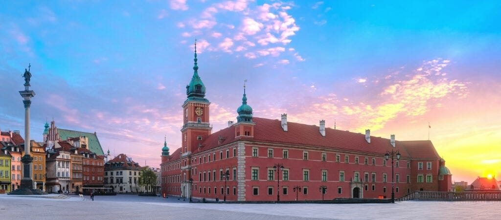 Panoramic view of the red brick building that is the royal castle in Warsaw Poland