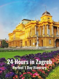 Zagreb Croatia National Theatre building - yellow stone lid up by the sun, blue sky with rainbow behind it and lush green grass and flowerbeds in the foreground - Writing: 24 hours in Zagreb - Perfect 1 Day Itinerary