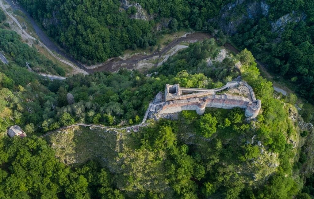 Aerial view of Poenari Castle Dracula Romania on a wooded hill in Romania